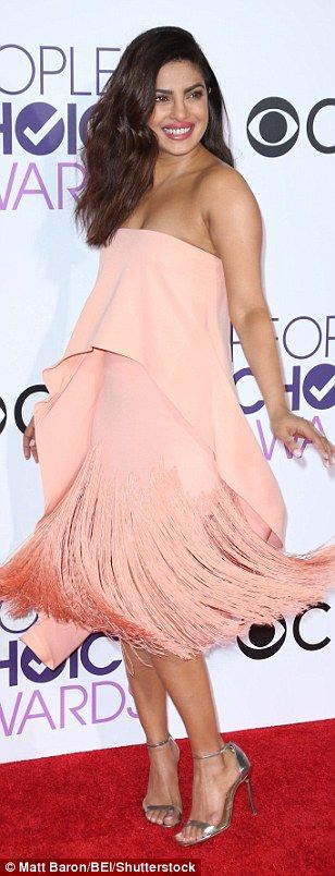 Just peachy! Priyanka Chopra twirled in a soft pink tiered dress with fringe detail...