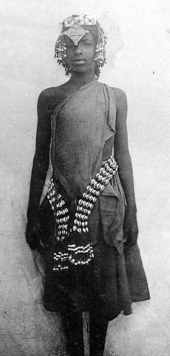 "Africa | ""Small Moslem woman in a festival costume"" Abyssinie Mission.  ca. 1900 - 1930 