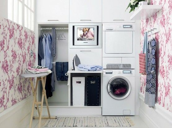 cute small laundry room...TV is a great touch!