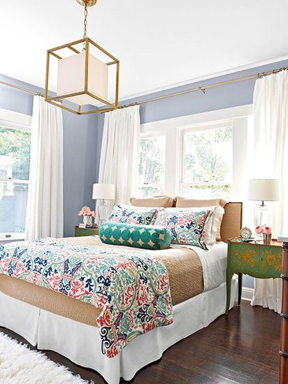 bedskirt...wall color...drapes...window above bed...colorful patterned duvel cover .. pendant light