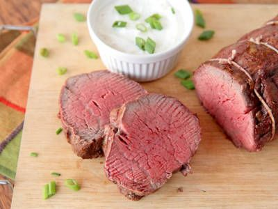 Beef Tenderloin With Horseradish Cream Sauce A whole beef tenderloin is slathered with butter and roasted in the oven for 20 minutes.  It is then covered in a basting sauce of scallions, butter, soy sauce, Dijon mustard, pepper and dry sherry.  After another 20 to 25 minutes it is cooked to the perfect medium-rare.  Carve into 1-inch slices and serve with a classic horseradish cream sauce.