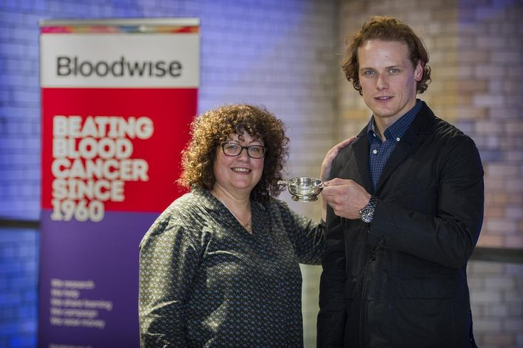 Photo: bloodwise.org.uk; Yvonne Dickson, Head of Regional Fundraising at Bloodwise, presents Sam Heughan with an engraved Scottish Quaich after he was named President of Bloodwise Scotland.