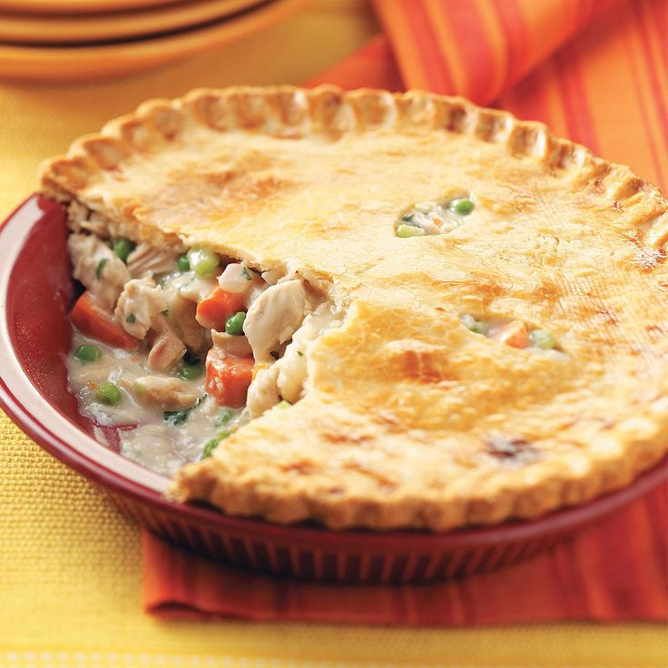 Turkey Potpies Recipe -With its golden brown crust and scrumptious filling, these comforting potpies will warm you down to your toes. Because it makes two, you can eat one now and freeze the other for later. They bake and cut beautifully. —Laurie Jensen, Cadillac, Michigan