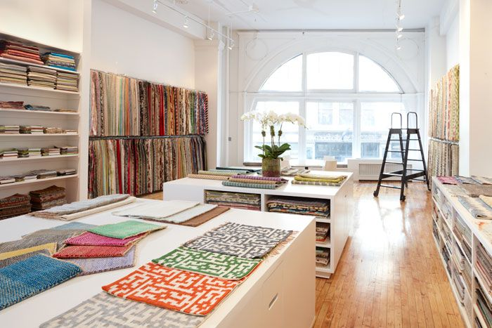 Carpet samples stored in Island bench..  Creates lots of extra storage..  studio four textiles @ 900 broadway - for fabrics
