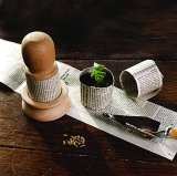 Use strips of newspaper to make pots for seedlings. Plant the whole thing in the ground.