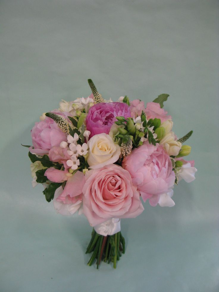 A Neat Hand Tied Of Roses, Peonies, Veronica, Bouvardia, Sweet Peas And