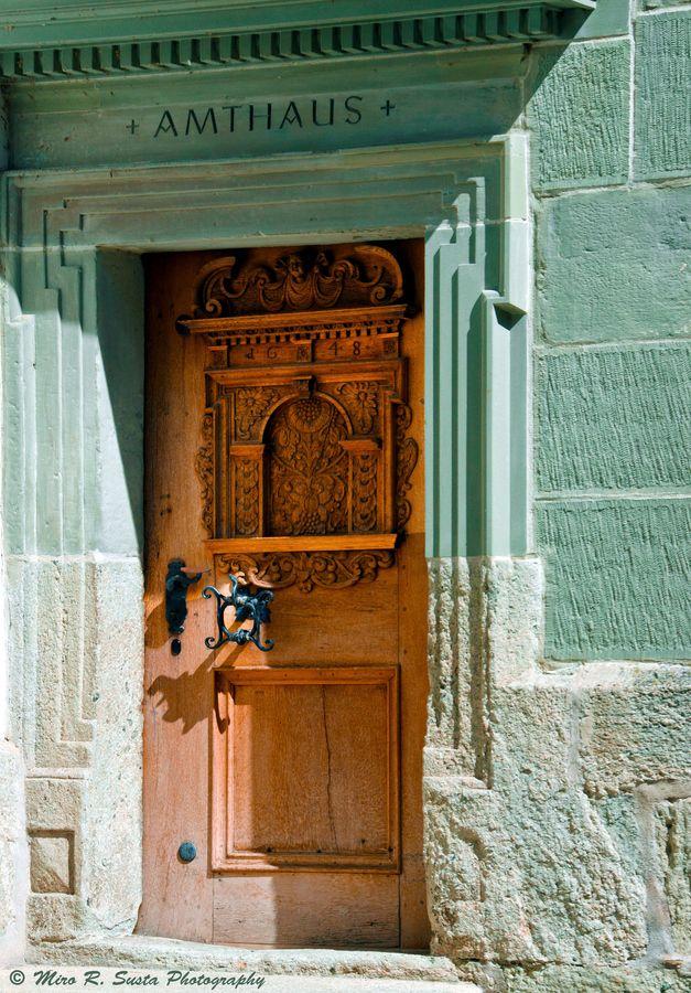 Wooden door of old City Hall in Swiss town of Laupen in Canton Bern, Switzerland