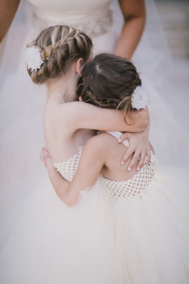 Flower Girl Hugs - See the wedding here: http://www.StyleMePretty.com/2014/05/14/garden-elegance-at-bella-collina/ #SMP - Photography: ByTheRobinsons.com