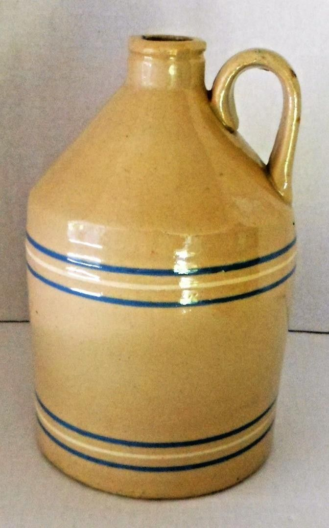 antique yelloware jug, blue & white bands