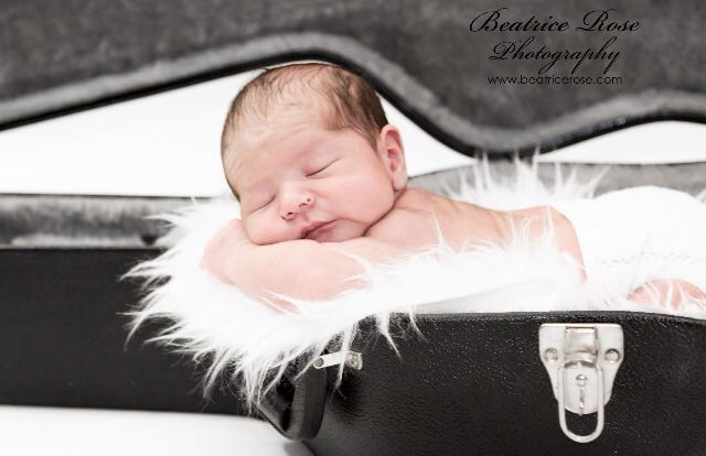 Newborn in a guitar case