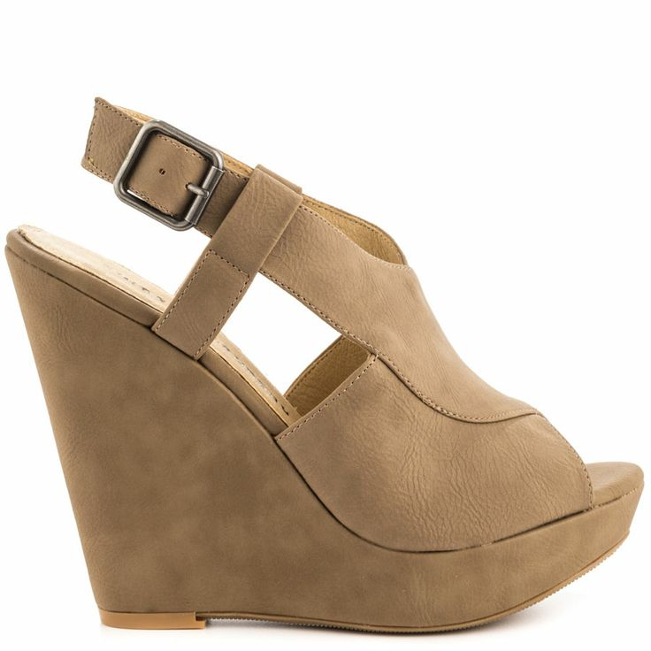 Make anything happen in the Mindy by Chinese Laundry. This versatile beige  look features a peep toe, open sides and adjustable ankle strap. A 5 inch  wedge ...