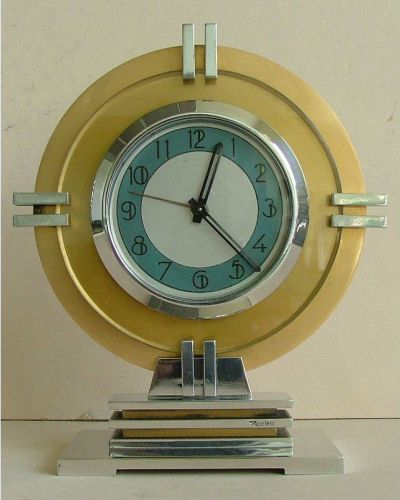 French streamline Moderne Art Deco clock, made from polished and anodized aluminum, signed by T Bourdeau