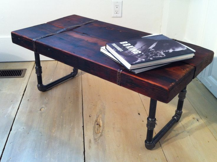 reclaimed industrial wood coffee table with pipe legs