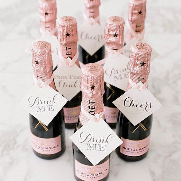 Surprising your wedding guests with mini champagne bottles is a terrific #WeddingIdea for #WeddingFavors - they can even be dressed up with pretty tags as seen on @huffpostweddings photo by @lesleemitchell