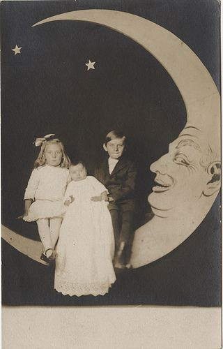 Hold On To the Baby! Three Siblings on a Paper Moon - Real Photo Postcard