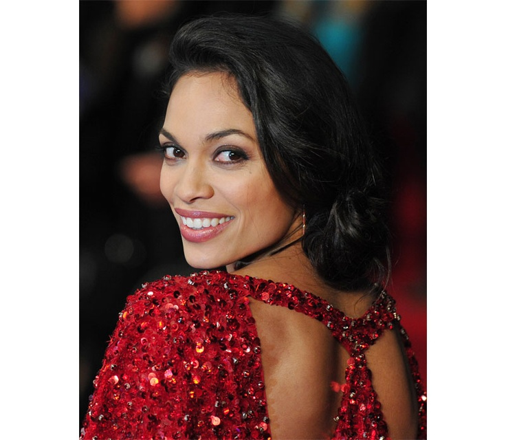 Rosario Dawson is a stunning lady in red at the premiere of her new movie Trance in London. (Photo by: Carl Court/AFP/Getty Images)