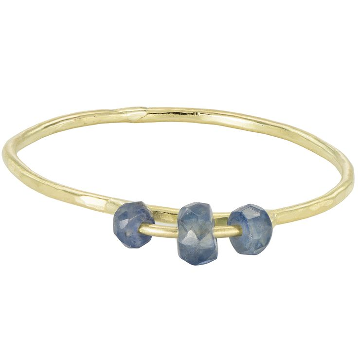 Natural blue sapphires adorn this dainty 18k gold ring.The precious gemstones' noble colour and shine are discreet but powerful. The gold band is hand hammered.  This dainty gemstone and gold ring is comfortable enough to be worn every day and will make you feel confident, stylish and precious. Designed in the UK and handcrafted in our studio.