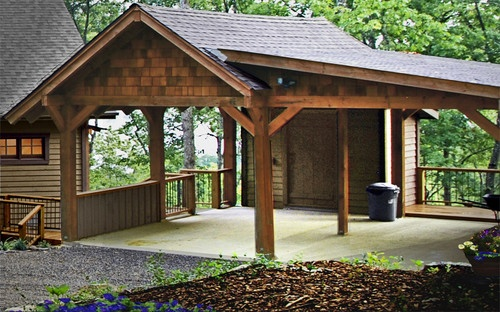 Carport traditional garage and shed cabin pinterest for Carport flooring ideas