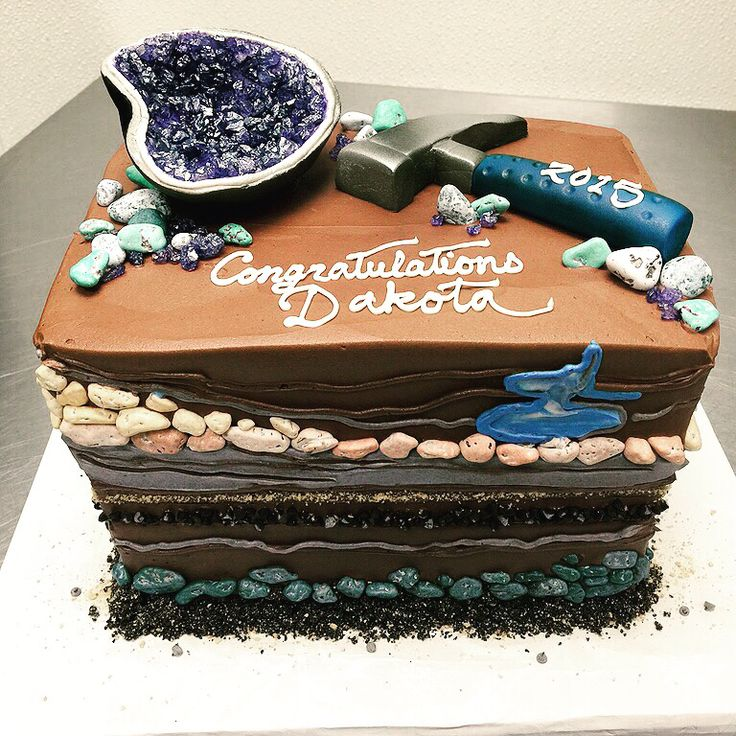 A geology themed cake with a fondant geode!