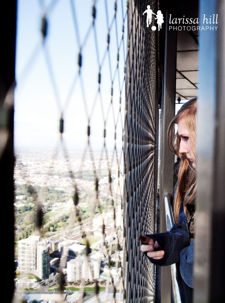 Eureka tower, view, vista, Melbourne, portrait, teenager, girl, fence, up high, high-rise,