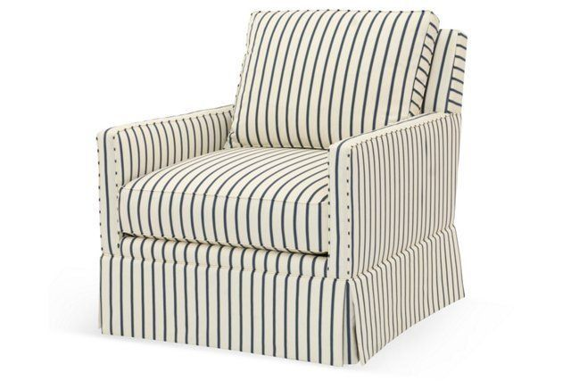Love the modern striped upholstery on this classic swivel chair.