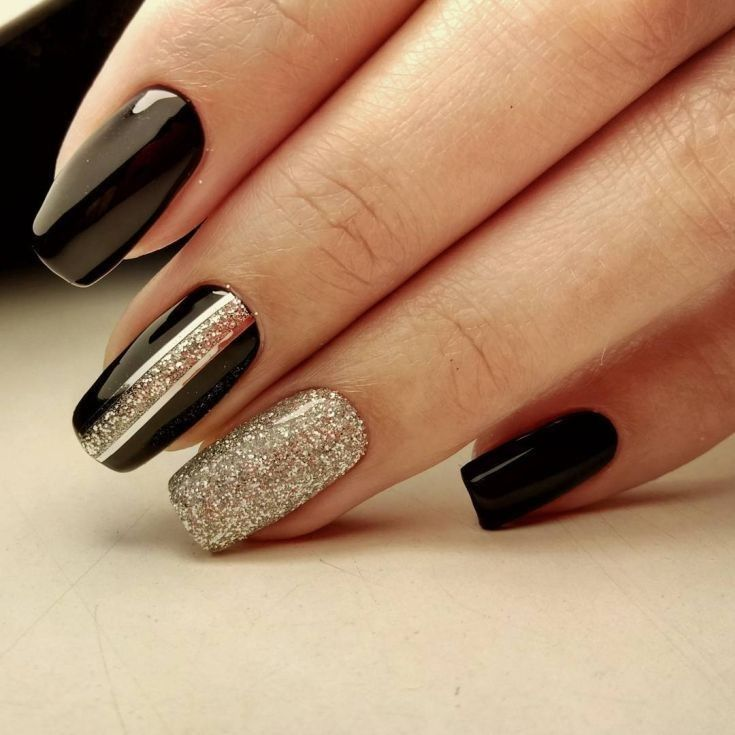 Black nails with silver glitter and vertical striping accents.  #nails #nailart …