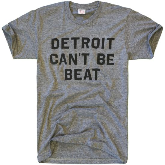 You+can't+keep+a+good+city+down.+Depressions,+recessions,+population+decline. Detroit+soldiers+up. <br></br> Comes+in+multiple+colors. <br> <br>Super+soft+tri-blend+cotton/poly/rayon+(50/25/25)+and+cotton/poly+blend+(50/50). <br> <br> <br>Designed+in+Michigan+by+The+Mitten+State. <br>Made+in+USA.