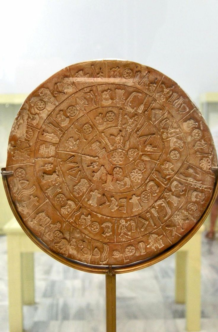 """""""Phaistos Disc"""", one of the most famous mysteries of archaeology (Heraklion Archaeological Museum), Crete Island, Greece"""