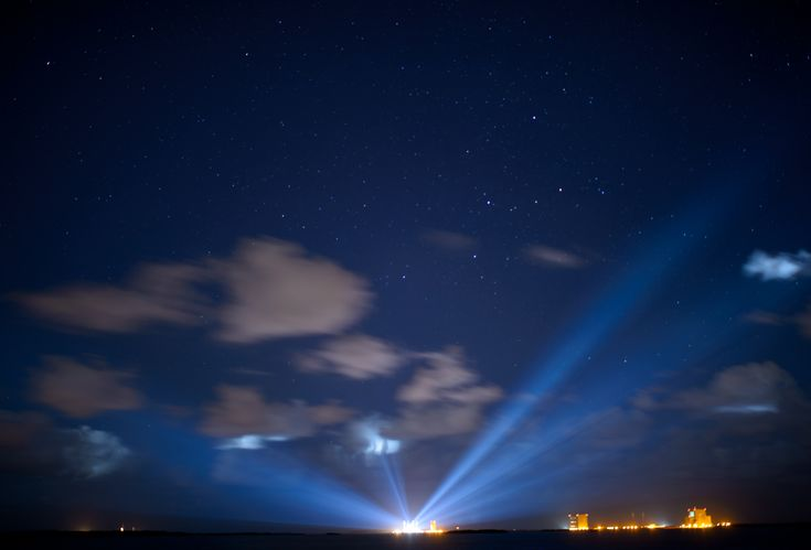 OSIRIS-REx Asteroid Sample Return Mission at the Launch Pad The ULA Atlas V rocket with NASA's Origins Spectral Interpretation Resource Identification Security-Regolith Explorer (OSIRIS-REx) spacecraft on board is seen illuminated in the distance in this thirty second exposure on Wednesday Sept. 7 2016 at Cape Canaveral Air Force Station in Florida. OSIRIS-REx is scheduled to launch  Sept. 8. September 08 2016