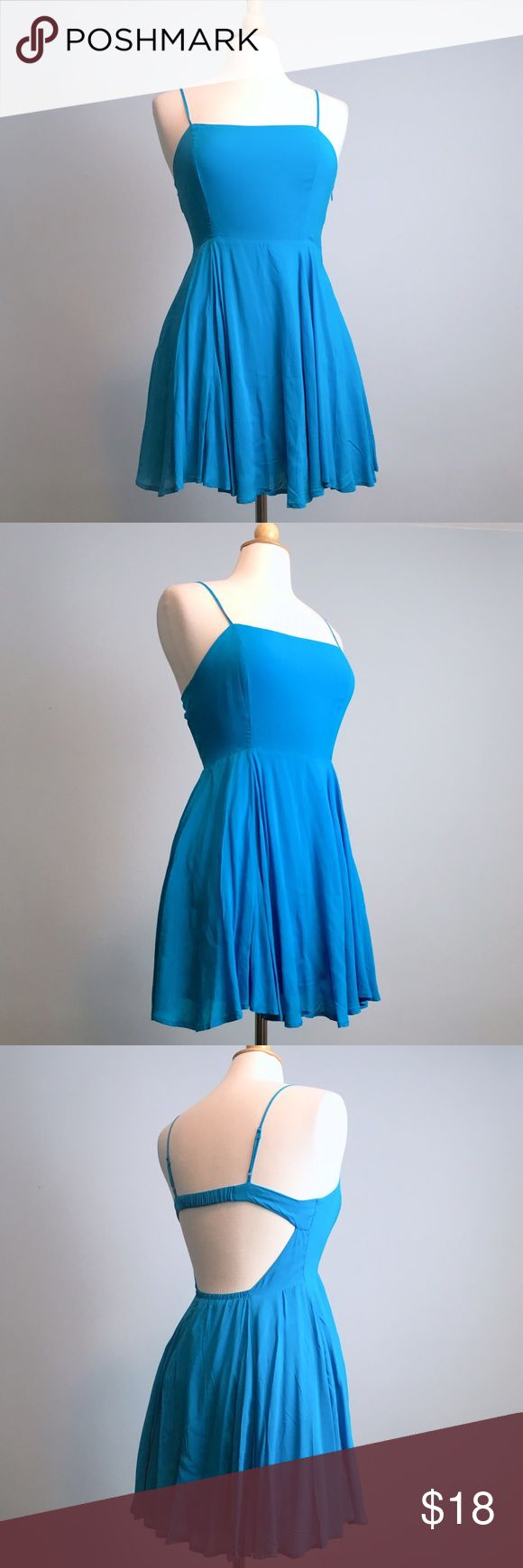 Forever 21 Blue Cut Out Back Skater Dress This electric blue flowy dress has a cut out back, full skirt and a zipper closure. Perfect for spring. It's only been worn once. Forever 21 Dresses Mini