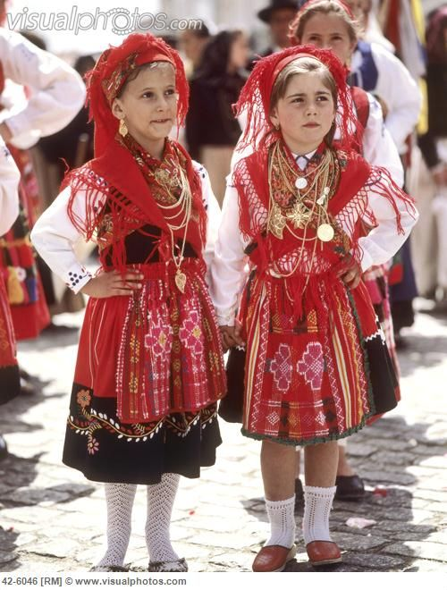 National Costume, Portugal wonderful outfits  i  love  how  thier little dresses  are brightly colored and with a  design  on them and gold necklaces around  thier  neck