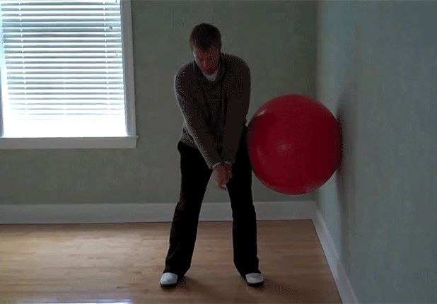 A lot of amateurs -- slicers especially -- use too much upper body on their downswing. To work on the correct motion, place a Swiss ball against a wall. As you practice making your downswing, use your hips to compress the ball against the wall.