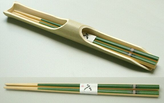 An attractive set of satin lacquered chopsticks and bamboo holder. With subtle style and harmonious colours, these will grace any dining table and enhance your Japanese theme. Length of chopsticks 225mm.