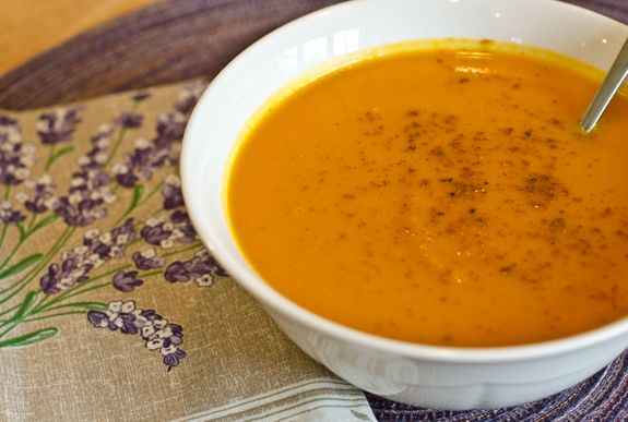 Autumn Carrot and Sweet Potato Soup - I love to make soup on Sundays, especially when it's cold outside and my family is curled up on the sofa watching football. There's something so relaxing about it -- clearing out the produce drawer, slow-cooking onions in butter, stirring a big pot as it simmers on the stove -- and it makes the house smell so inviting! This savory soup with a hint