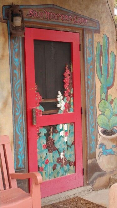 Carved wood hollyhocks screen door on the Turquoise Trail near Santa Fe.