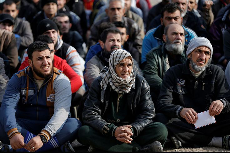 Men sit on the ground as an Iraqi Special forces intelligence team checks their ID cards in a search for Islamic State fighters in Mosul, Iraq, on Sunday.