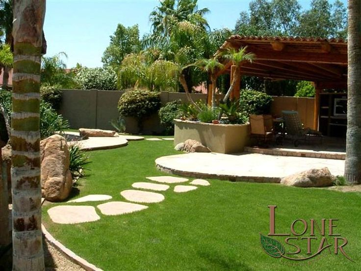 This Backyard Is An Oasis With Grass, Flagstone Stepstones