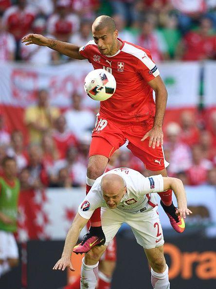 #EURO2016 Switzerland's forward Eren Derdiyok vies for the ball with Poland's defender Michal Pazdan during the Euro 2016 round of sixteen football match...