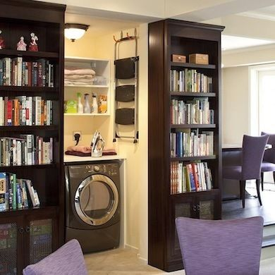 Not relegated to the cellar or mudroom, this laundry room is incorporated into the main living area of the house thanks to sliding bookcases...