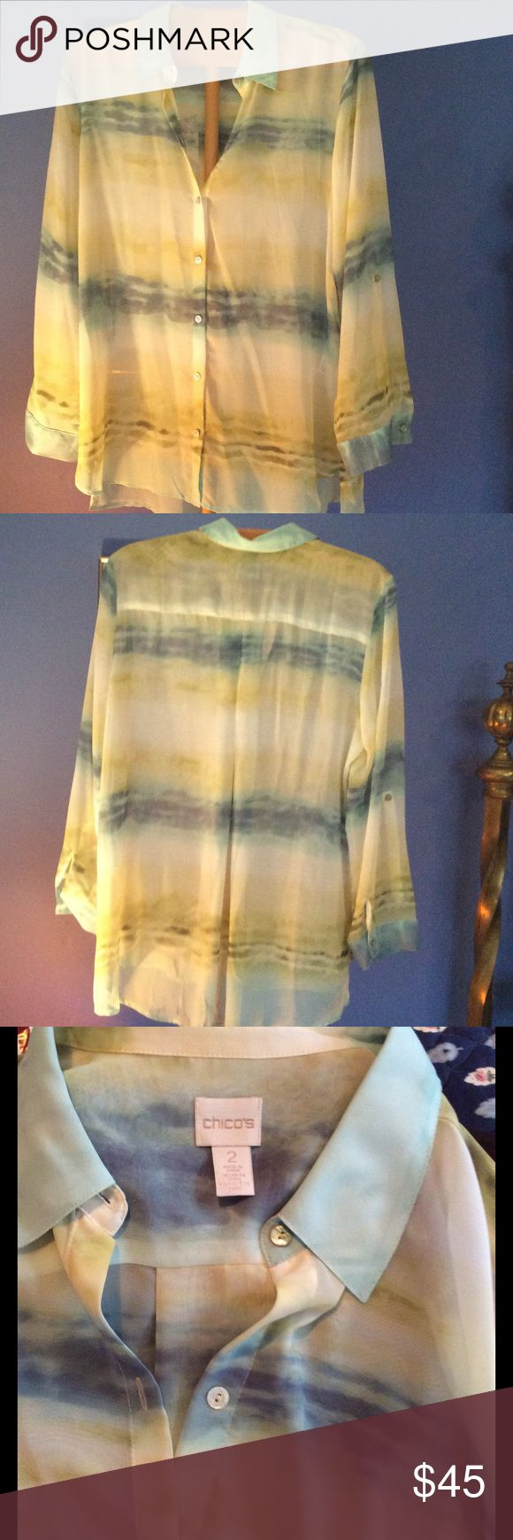 Chico's Flowing Tunic Blouse Such a pretty semi sheer long button up top with long sleeves and pleat in back. Shades of spring with Blue and Green Chico's Tops Tunics