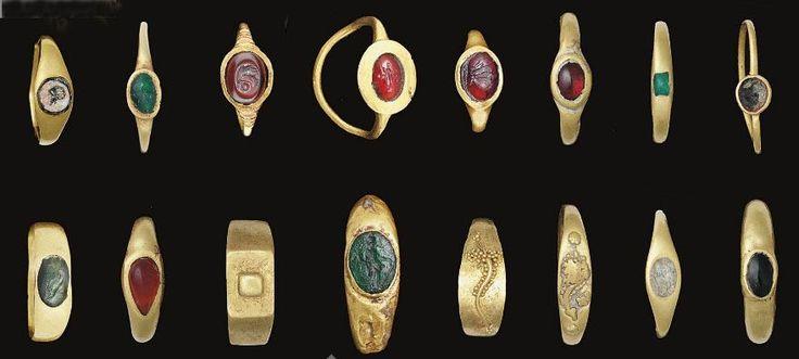 16 Roman gold rings, c. 1st century B.C.-3rd century A.D., set with emeralds, garnet, carnelian and jasper (some engraved)