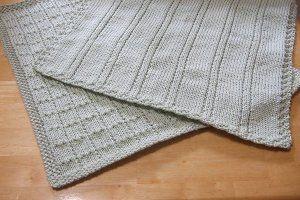 "Simple Lines Baby Blankets - stitch pattern on vertical strip:  12 stitches + 7, ""blocks"" is 12 stitches + 6"