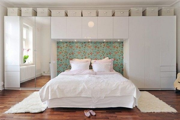 Contemporary Bedroom with Storage, now this is different. I love the cloth storage containers above.