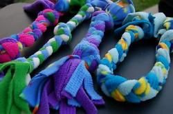old fleece clothing cut into strips and braided for a dog toy