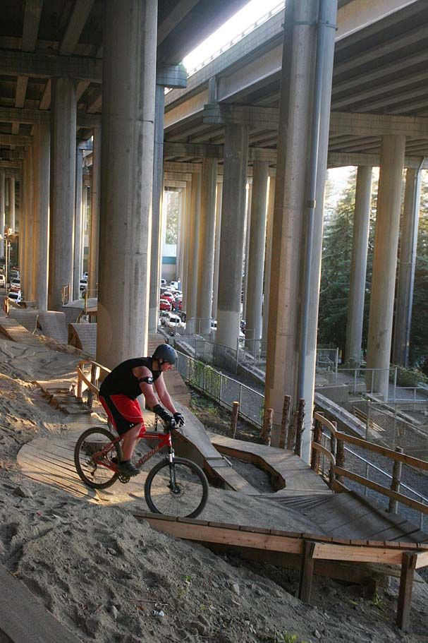 mountain bike park under and interstate...genius! Seattle I-5. Come and visit our MTB super store - http://WhatIsTheBestMountainBike.com/ - #WhatIsTheBestMountanBike