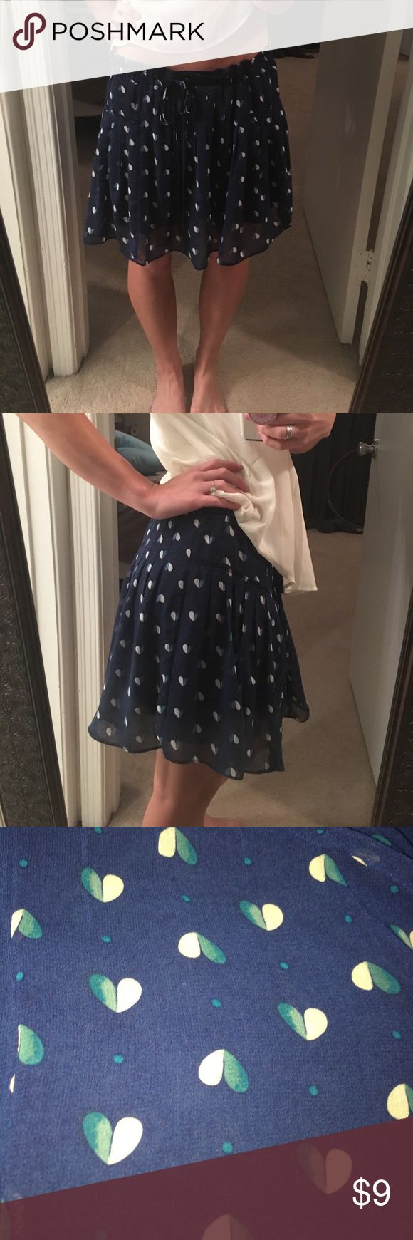 Navy 2 layered sheer American Eagle skirt Worn a few times. No flaws. Size M. Ties at the waist. I am 5'1 and it hits my knees American Eagle Outfitters Skirts Mini