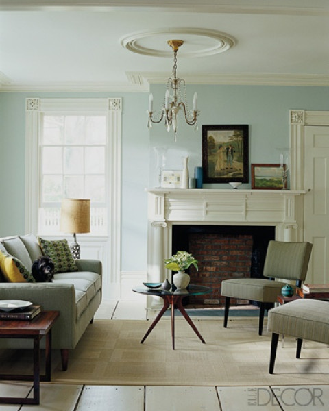 Contemporary furniture in a house with colonial details (soothing wall color, clean lines of couch and chairs)