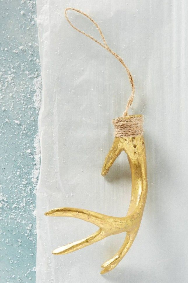 Hang this stunning gold antler ornament from your tree or mantel.