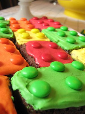 {Lego Brownies} Just bake up a batch of your favorite brownies, frost in bright primary colors, and top with assorted matching candy pieces. There are other awesome ideas on this site for a Lego themed party. *Love the simplicity