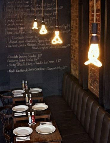 I want to eat here, love the bulbs and dark earthy materials, also wish I had cool handwriting to fill a chalkboard.